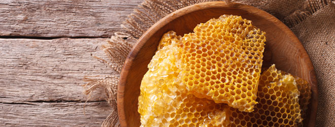 Honeycomb in a bowl. Verify your honey source with True Source Certification.