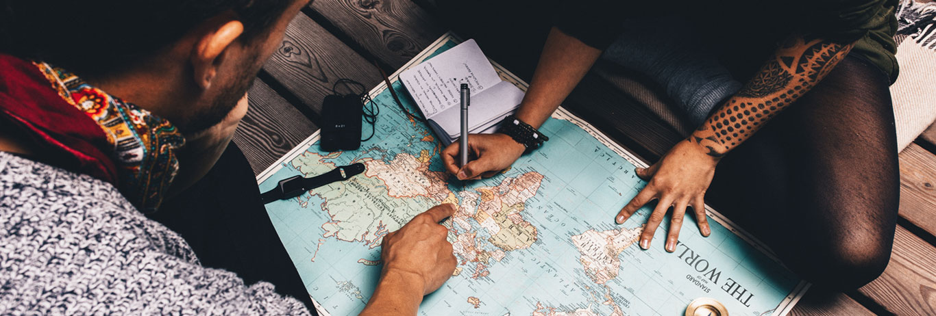 Two people studying a map. Find your way using QAI's map for certification.