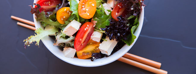 Salad greens and tofu, which are products certified organic by QAI.