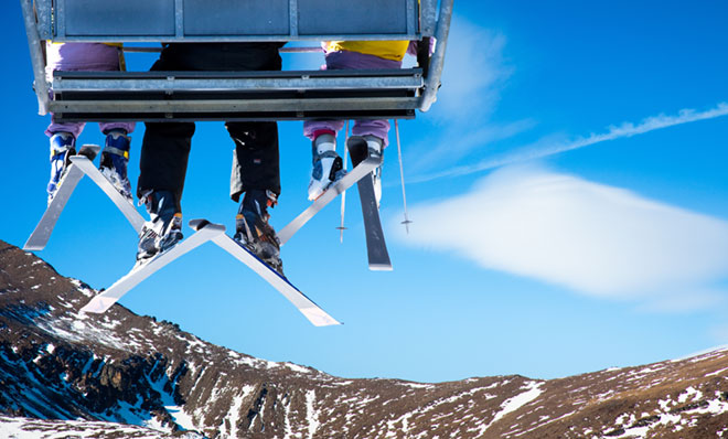 Three people on a ski chair lift. Get the view of international organic certification with QAI.