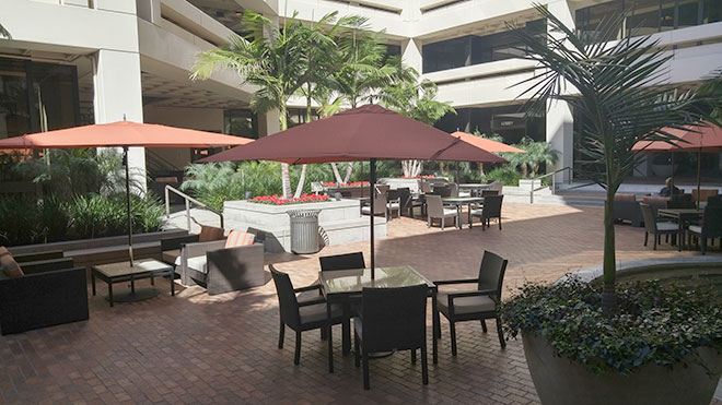 Outdoor tables with umbrellas.